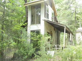 FIXER-UPPER GUEST QUARTERS BURIED IN THE WOODS