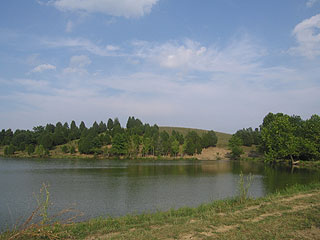 OVERLOOKS SMALL LAKE FOR FISHING, SWIMMING, CANOEING