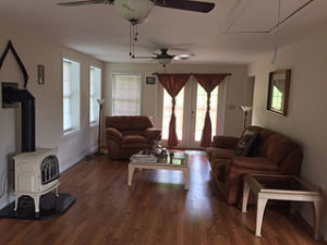 SPACIOUS LIVING ROOM OPENS TO PORCH