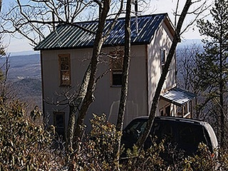 TWO-STORY, TWO-ROOM CABIN HAS SLEEPING LOFT