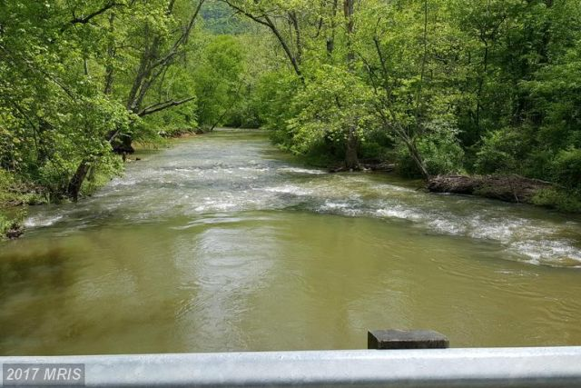 JUST 5 MINUTES FROM ROARING TROUT STREAM