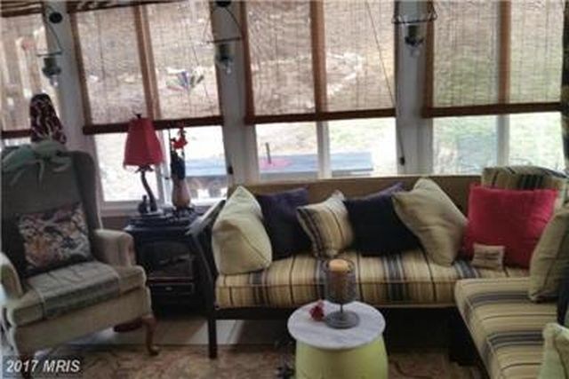 SUN-ROOM FOR QUIET TALK, READING, AND RECREATION