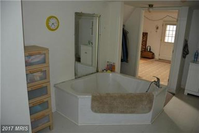LARGE BATHROOM CAN BE REMODELED FOR 2 BATHS