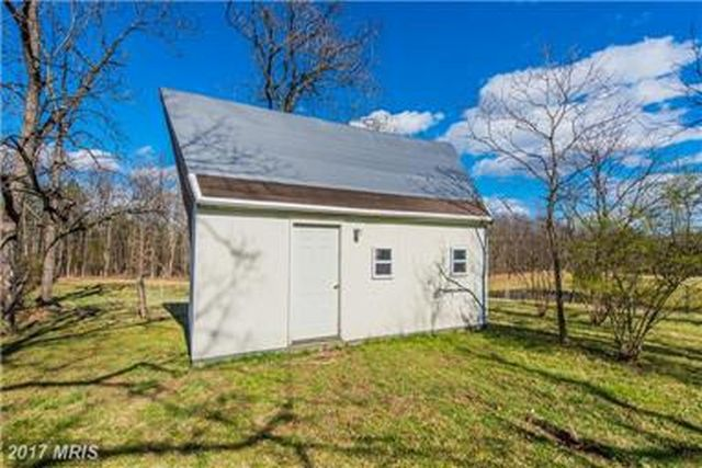 Grounds include sturdy garage and outbuilding.