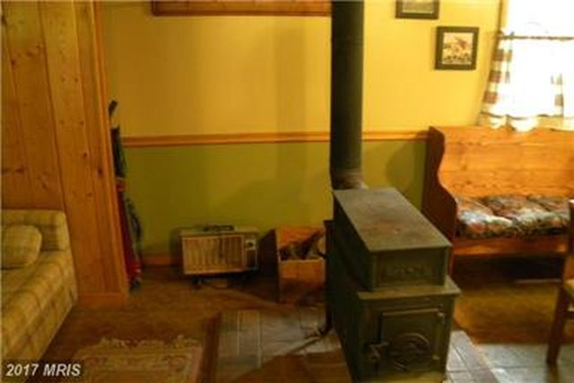 SAVE MONEY W/ WOOD STOVE. PUBLIC WATER AVAILABLE